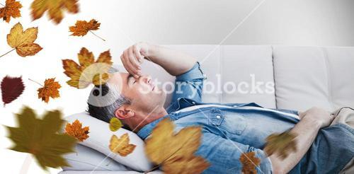 Composite image of man suffering from headache while on sofa