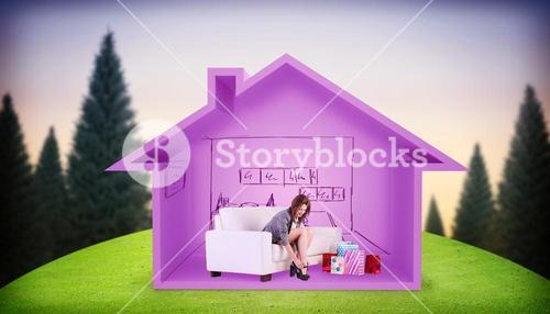 Composite image of cute woman sitting on couch taking off her shoes