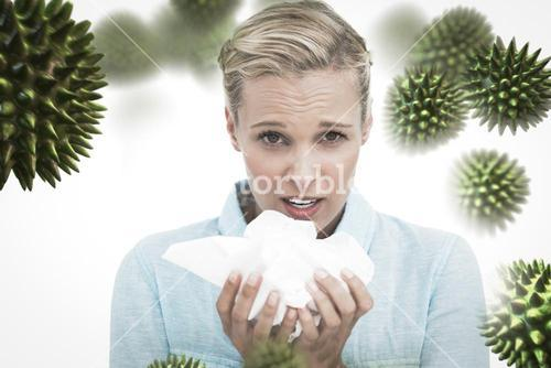 Composite image of blonde sick woman holding lots of tissues
