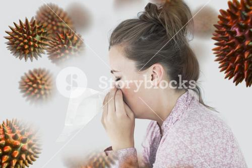 Composite image of young woman blowing her nose