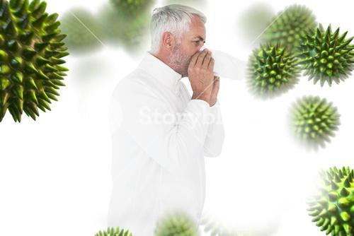 Composite image of sick man in winter fashion sneezing