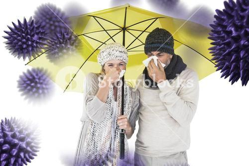 Composite image of couple sneezing in tissue while standing under umbrella