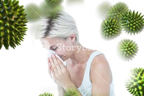 Composite image of sick woman blowing her nose