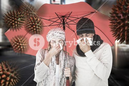 Composite image of ill couple sneezing in tissue while standing under umbrella