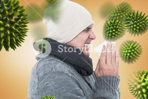 Composite image of casual man about to sneeze
