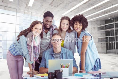 Composite image of fashion students working as a team