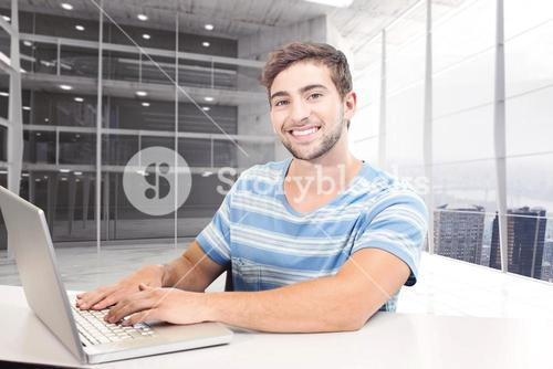 Composite image of student on laptop