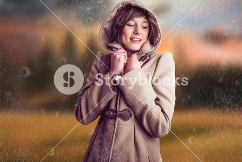 Composite image of smiling woman in winter coat