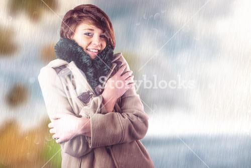 Composite image of portrait of beautiful woman in winter coat