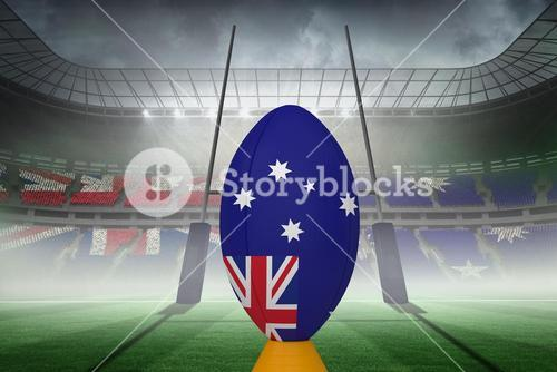 Composite image of australian flag rugby ball on stand