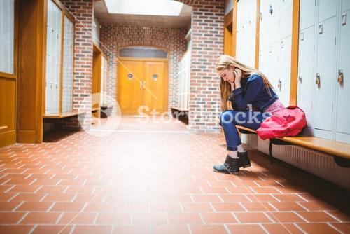 Worried student sitting and looking down