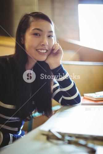 Smiling student in lecture hall