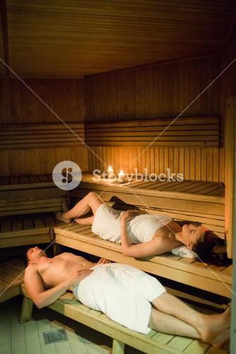 Couple relaxing in the sauna