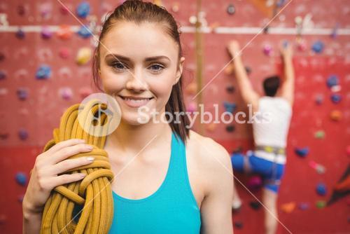 Fit woman at the rock climbing wall