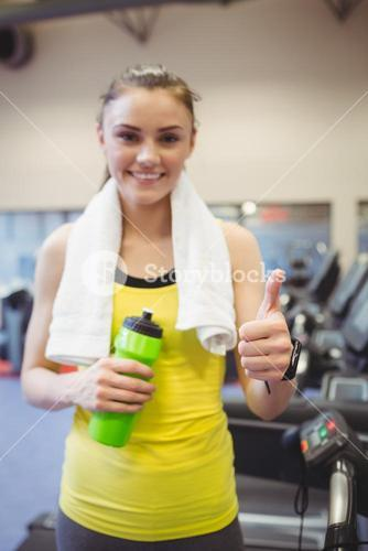 Fit woman using the treadmill