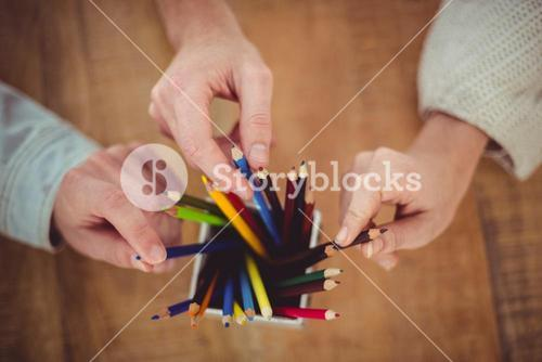 Creative team choosing different coloured pencils