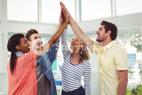 Happy creative team giving a motivational gesture
