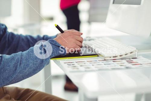Graphic designer at their desk