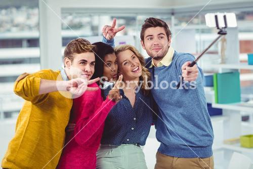 Smiling creative team posing for a selfie
