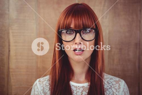 Surprised hipster woman posing face to the camera