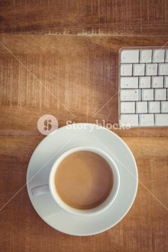 Business desk with coffee cup and keyboard