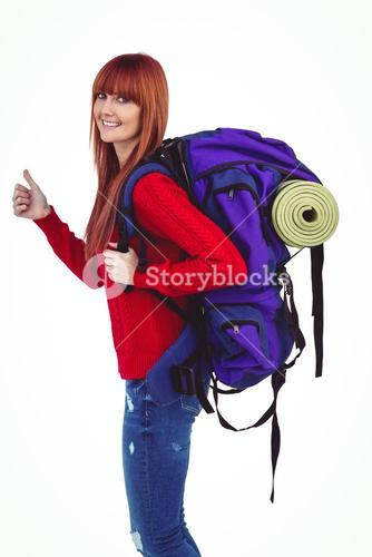 Smiling hipster woman with a travel bag