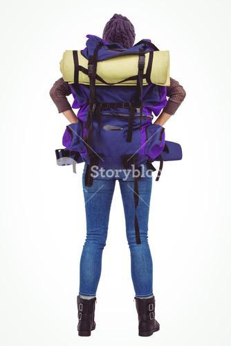 Rear view of a hipster woman with a travel bag