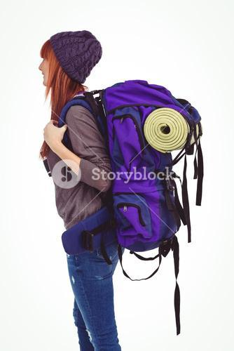 Side view of a hipster woman with a travel bag