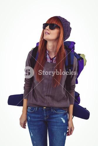 Portrait of a hipster woman with a travel bag
