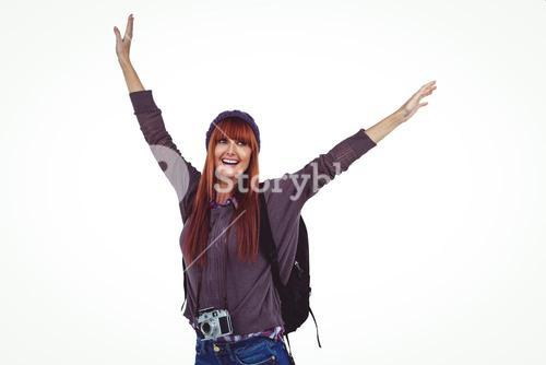 Smiling hipster woman with hands up