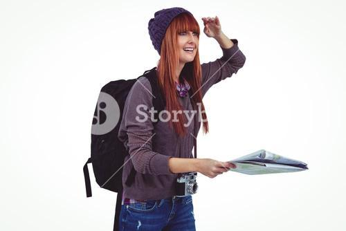 Smiling hipster woman with a map