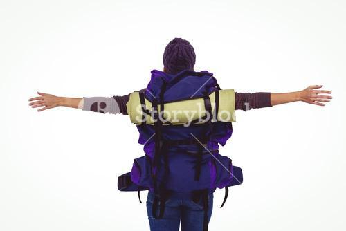 Rear view of a hipster woman with arms outstretched
