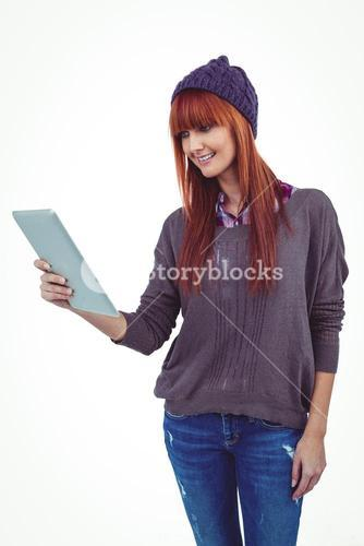 Smiling hipster woman using her tablet