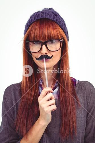 Smiling hipster woman with mustache