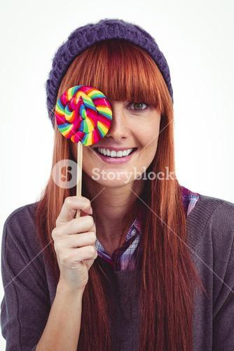Smiling hipster woman with a lollipop