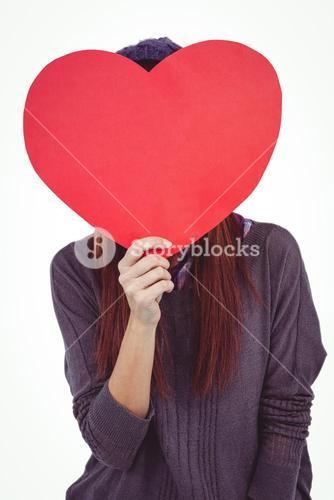 Hipster woman behind a red heart
