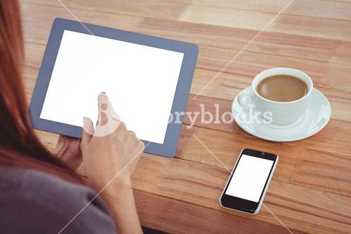 Over shoulder view of hipster woman using tablet
