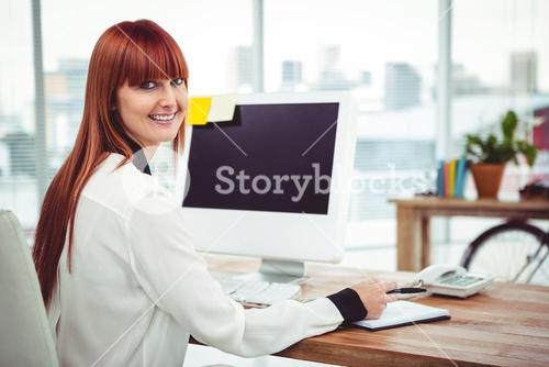 Hipster businesswoman using her computer
