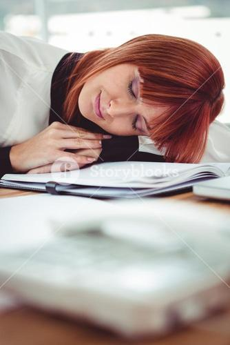 Hipster businesswoman falling in sleep at her desk