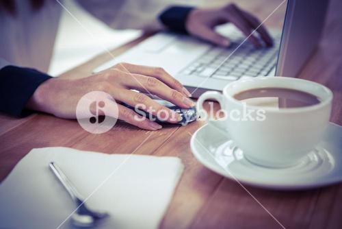 Hipster businesswoman using her laptop