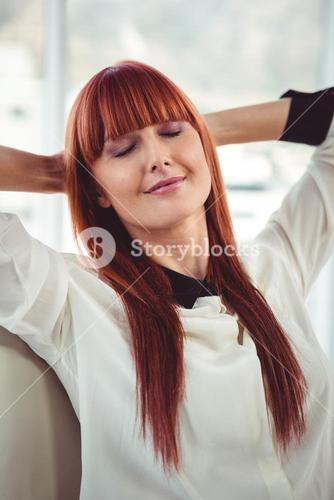 Hipster businesswoman with outstretched arms