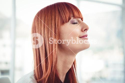 Side view of a hipster businesswoman