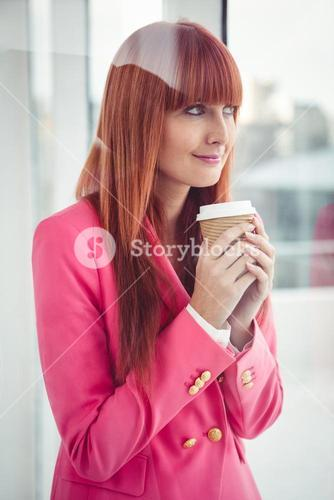 Portrait of a hipster businesswoman holding a coffee cup