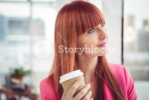 Portrait of a hipster businesswoman drinking a coffee cup