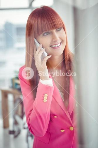 Hipster businesswoman having a phone call