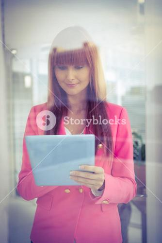 Hipster businesswoman using her tablet
