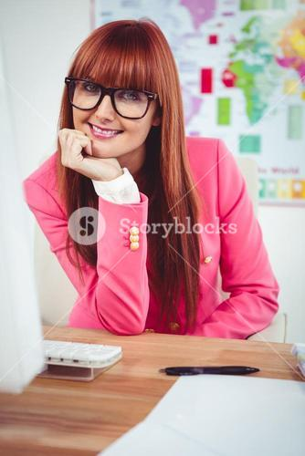 Smiling hipster businesswoman using her computer