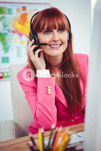 Smiling hipster businesswoman using headset