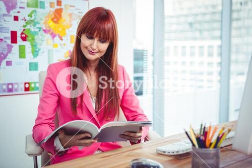 Portrait of a hipster businesswoman at her desk