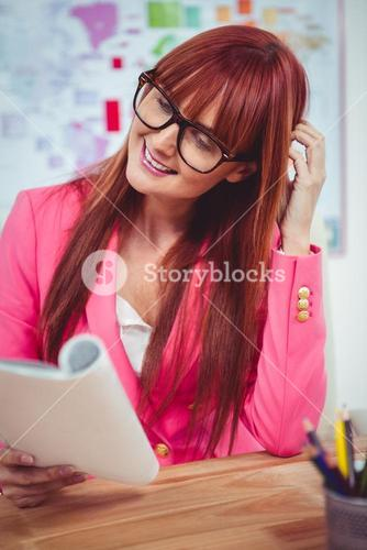 Smiling hipster woman with a book